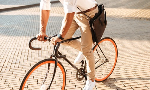 guy riding to work on a bicycle